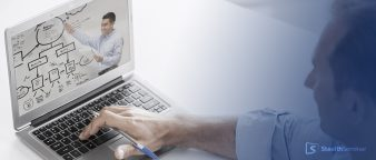a man on his laptop listening to a webinar